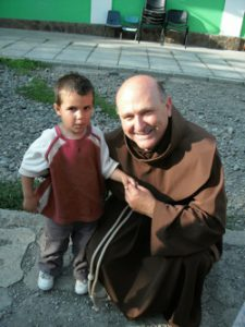 Father Paul with one of the children