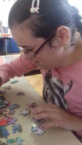 Enjoying a jigsaw in the Day centre
