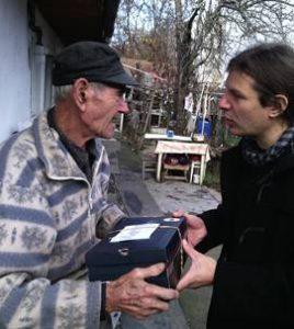 Medicare nurse Janos delivers a food parcel to old Janos